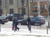 Police escort another handcuffed heckler away.