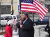 Kurt Jacobson of Knights of Columbus holds the flag.