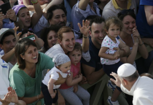 Pope Francis reaches for babies