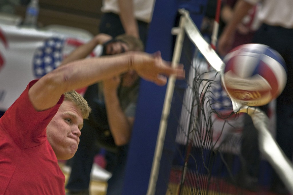 0420-1007-3011-4011_man_spiking_a_volleyball_over_the_net_o