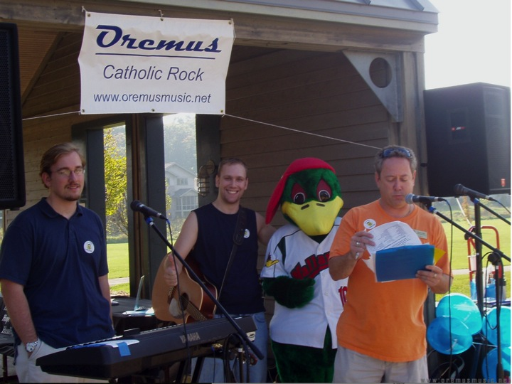 Oremus performing at a CareNet benefit sponsored by Madison Mallards and Relevant Radio Madison- with Brian Kelly of Relevant Radio, and the Mallards Duck